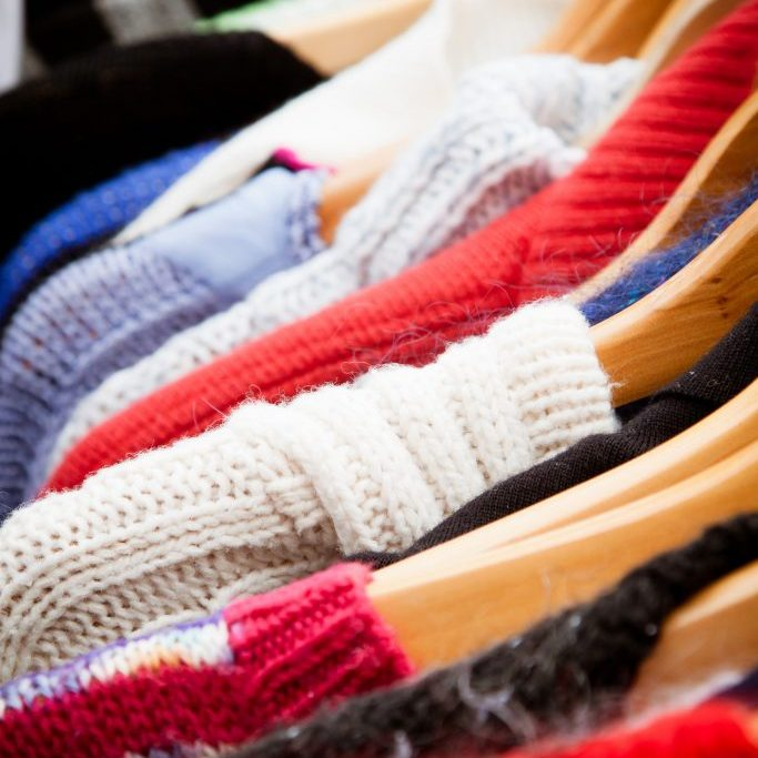 sweaters in thrift store